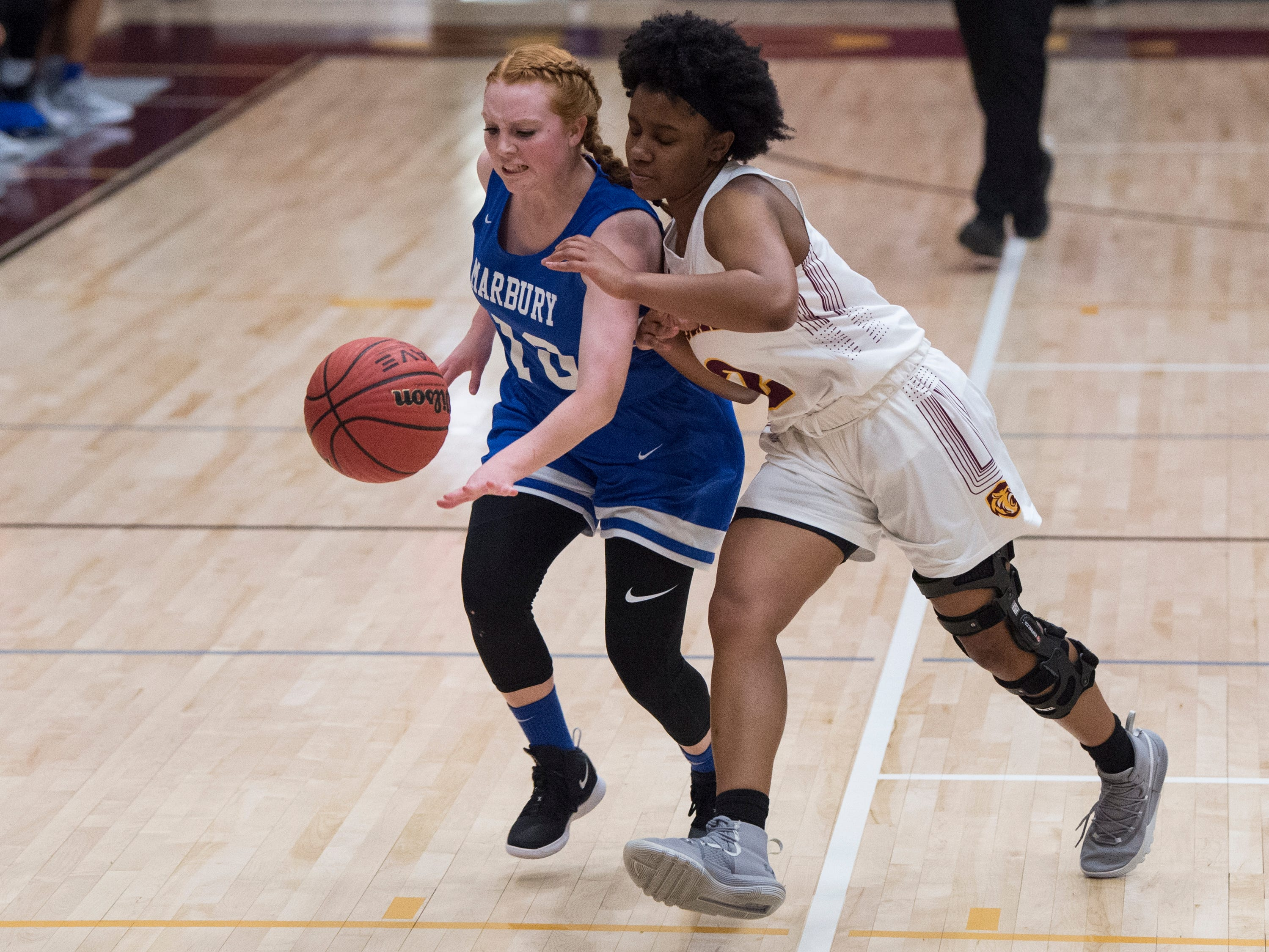 Marbury's Mary Bixler (10) steals the ball from LAMP's Aariel Johnson (2) at LAMP high school in Montgomery, Ala., on Thursday, Jan. 10, 2019.