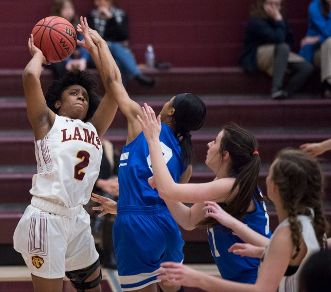 LAMP's Aariel Johnson (2) takes a shot against Marbury at LAMP high school in Montgomery, Ala., on Thursday, Jan. 10, 2019.