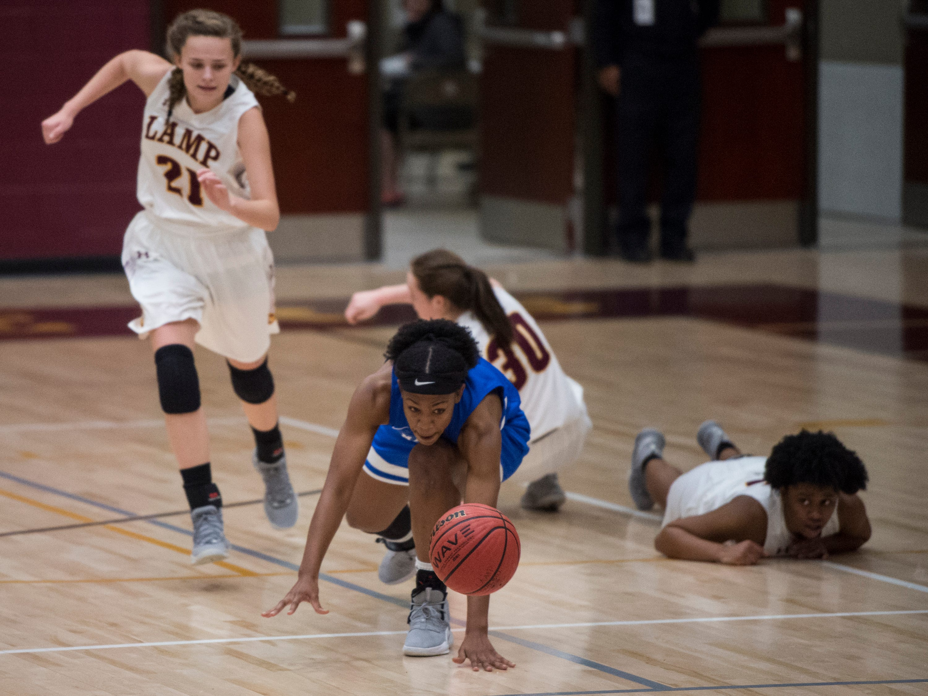 Marbury's Renijah Brown (3) fights for a loose ball against LAMP at LAMP high school in Montgomery, Ala., on Thursday, Jan. 10, 2019.