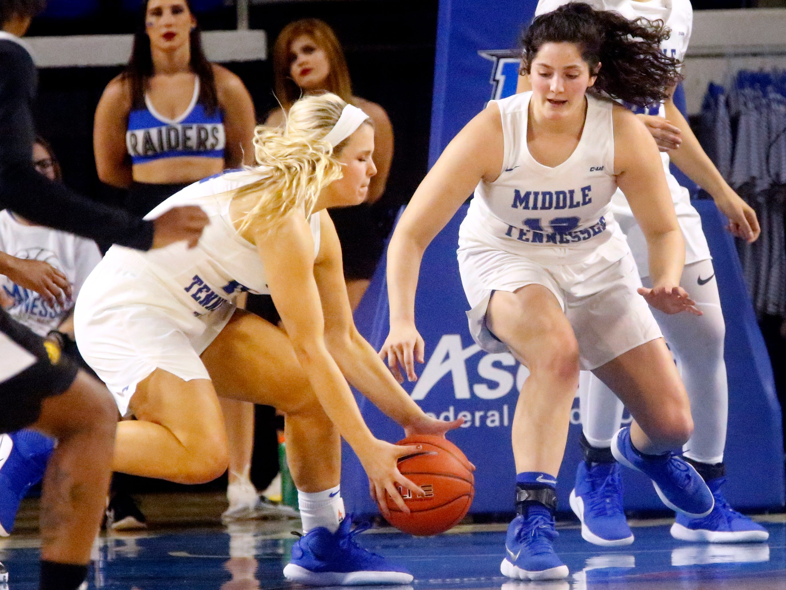 MTSU's guard Katie Collier (14) picks up a loose ball as MTSU's guard Jess Louro (12) goes after the same ball on Thursday Jan. 10, 2019 during the game against Southern Miss.