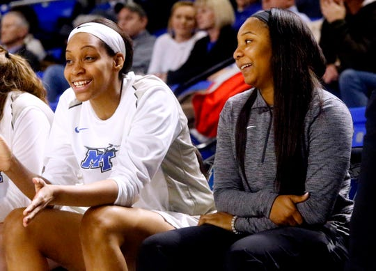Anastasia Hayes, right, on the sidelines with MTSU's center Jadona Davis (11), left during the game against Southern Miss, on Thursday Jan. 10, 2019.