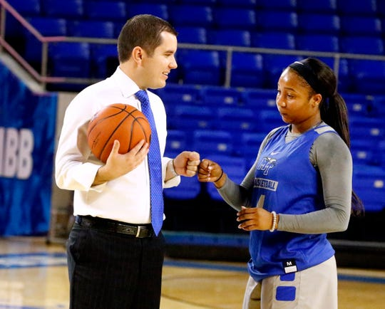 MTSU's assistant women's coach Matt Insell and MTSU's Anastasia Hayes interact during a workout before the Southern Miss game on Thursday Jan. 10, 2019.