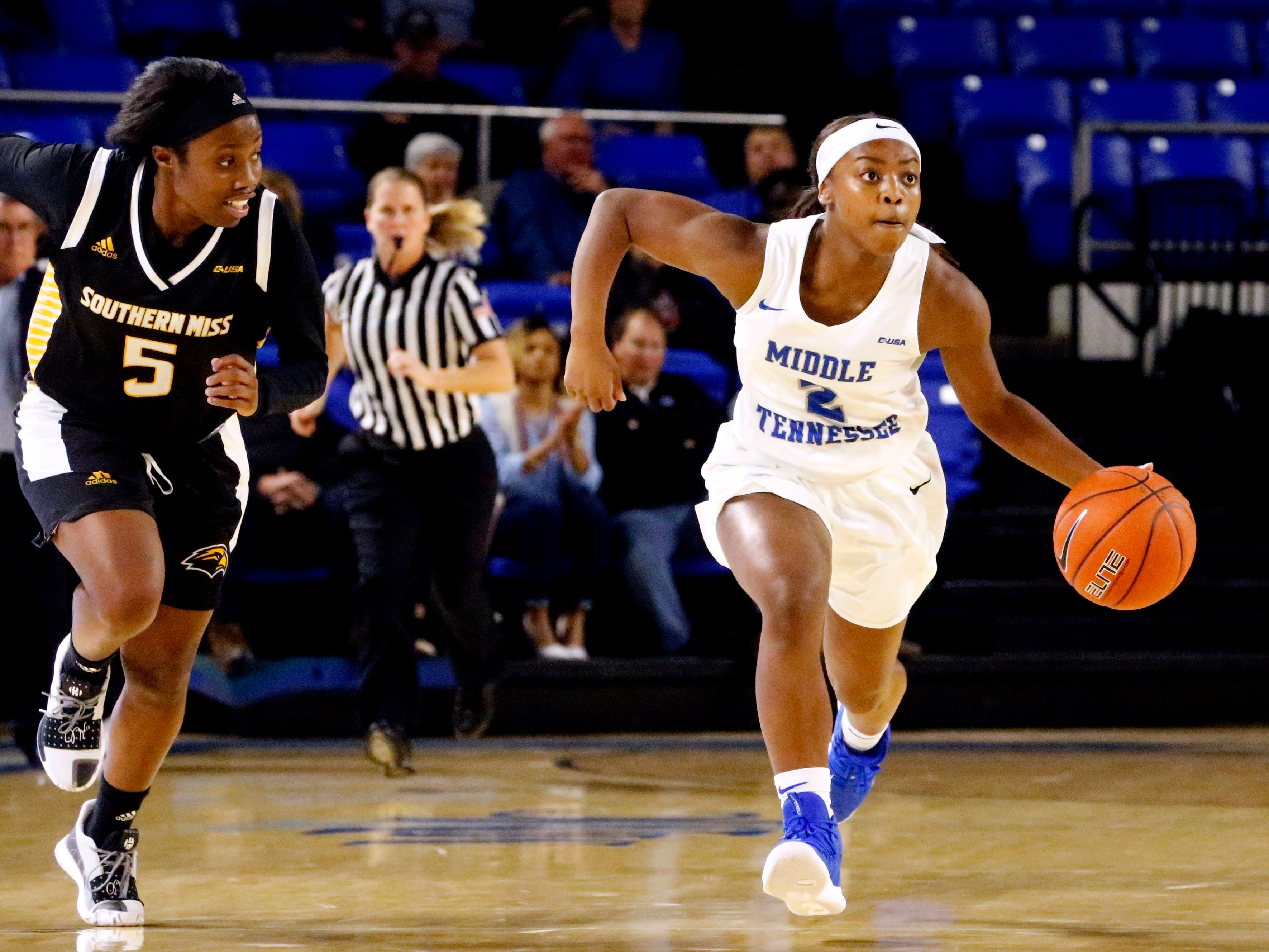 MTSU's guard Taylor Sutton (2) brings the ball down the court s Southern Miss' Shonte Hailes (5) follows beside her, on Thursday Jan. 10, 2019.