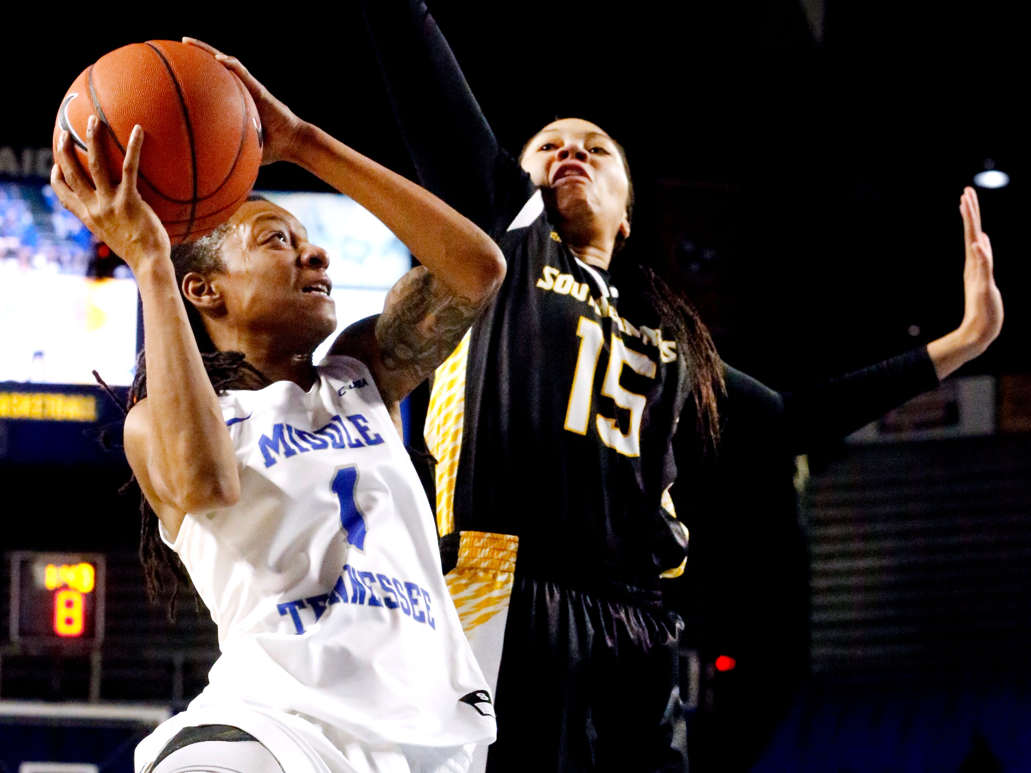 MTSU's guard A'Queen Hayes (1) goes up for a shot s Southern Miss' Amber Landing (15) guards her, on Thursday Jan. 10, 2019.