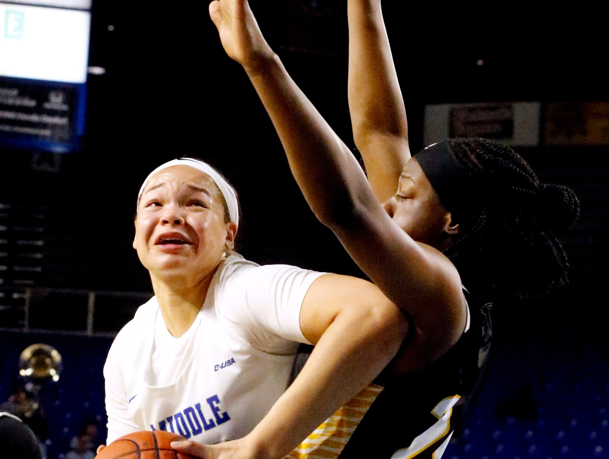 MTSU's forward Alex Johnson (00) tries to shoot the ball as she is guarded by Southern Miss' Kennedy Gavin (24) on Thursday Jan. 10, 2019.