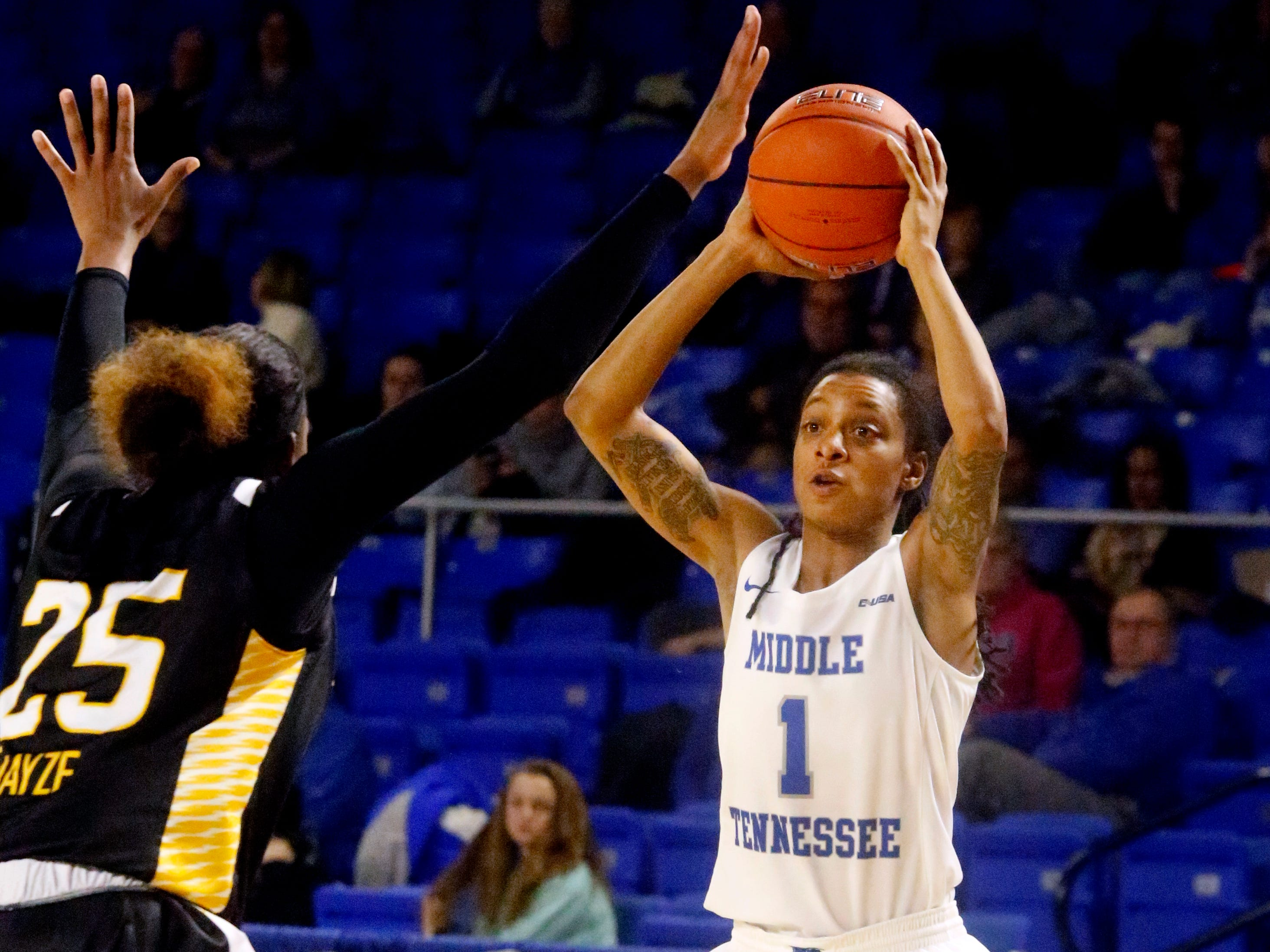 MTSU's guard A'Queen Hayes (1) looks for an open player as Southern Miss' Alarie Mayze (25) guards her on Thursday Jan. 10, 2019.