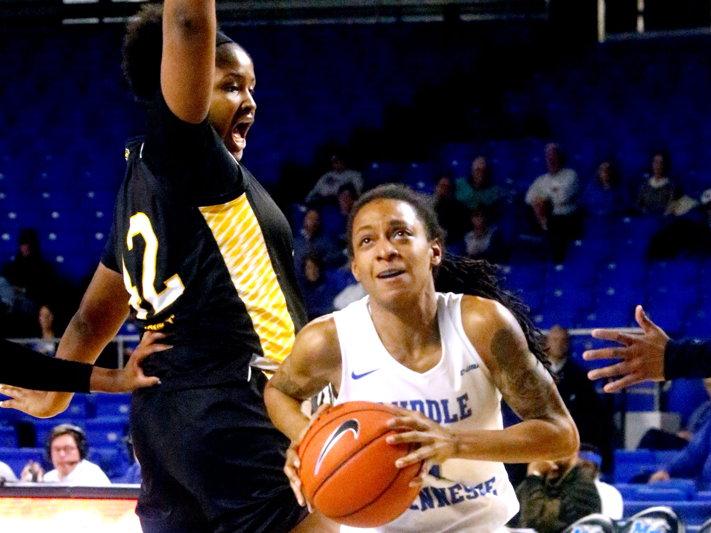 MTSU's guard A'Queen Hayes (1) goes up for a shot as Southern Miss' Kelsey Jones (42) guards her on Thursday Jan. 10, 2019.