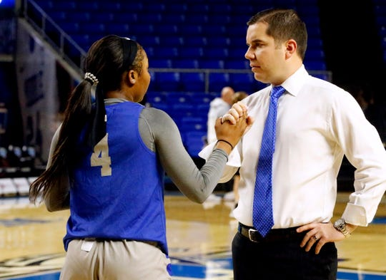 MTSU's assistant women's coach Matt Insell and MTSU's Anastasia Hayes interact after her workout before the Southern Miss game on Thursday Jan. 10, 2019.