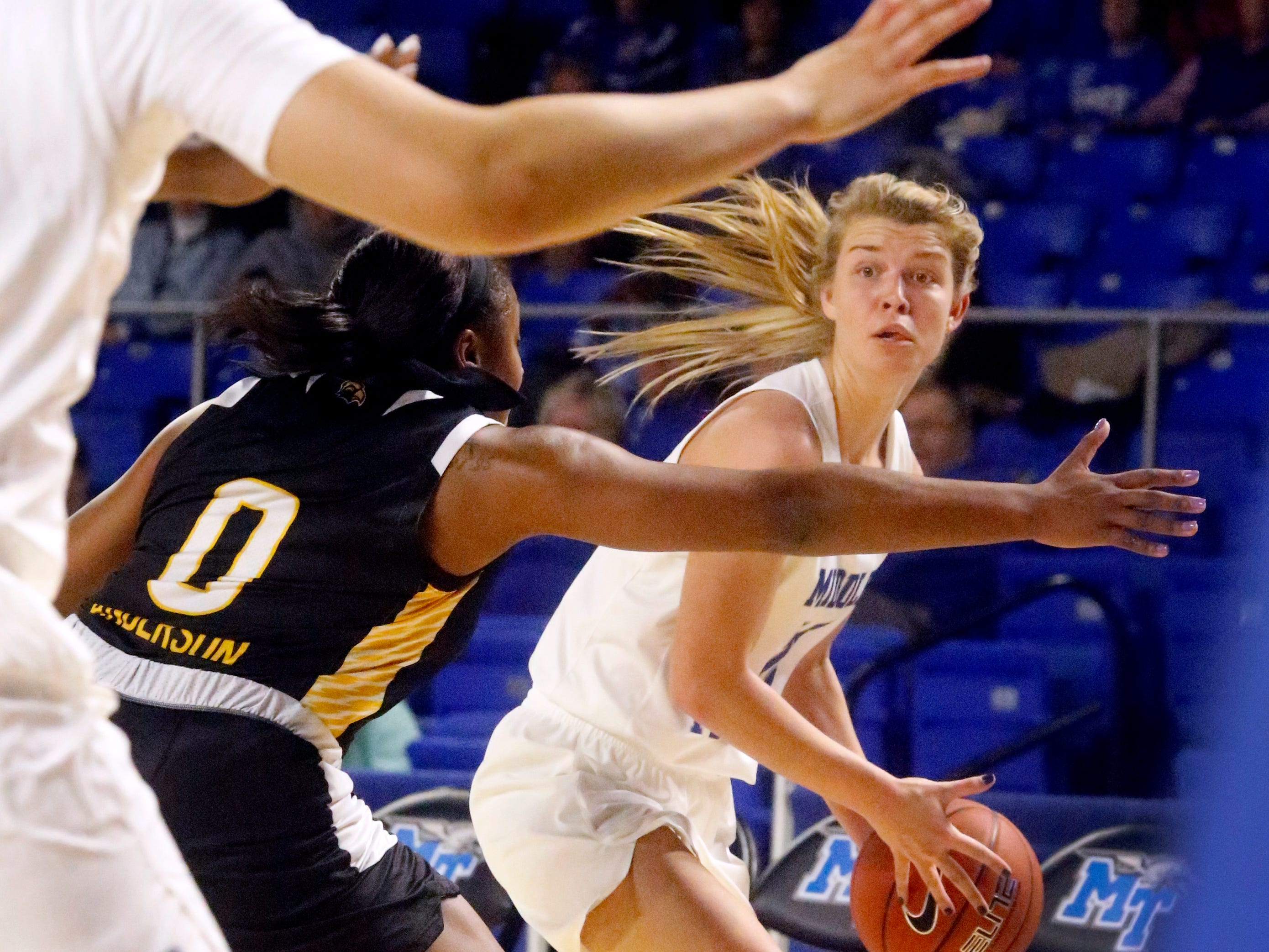 MTSU's guard Anna Jones (15) looks for a player to pass to as Southern Miss' Camille Anderson (0) guards her, on Thursday Jan. 10, 2019.