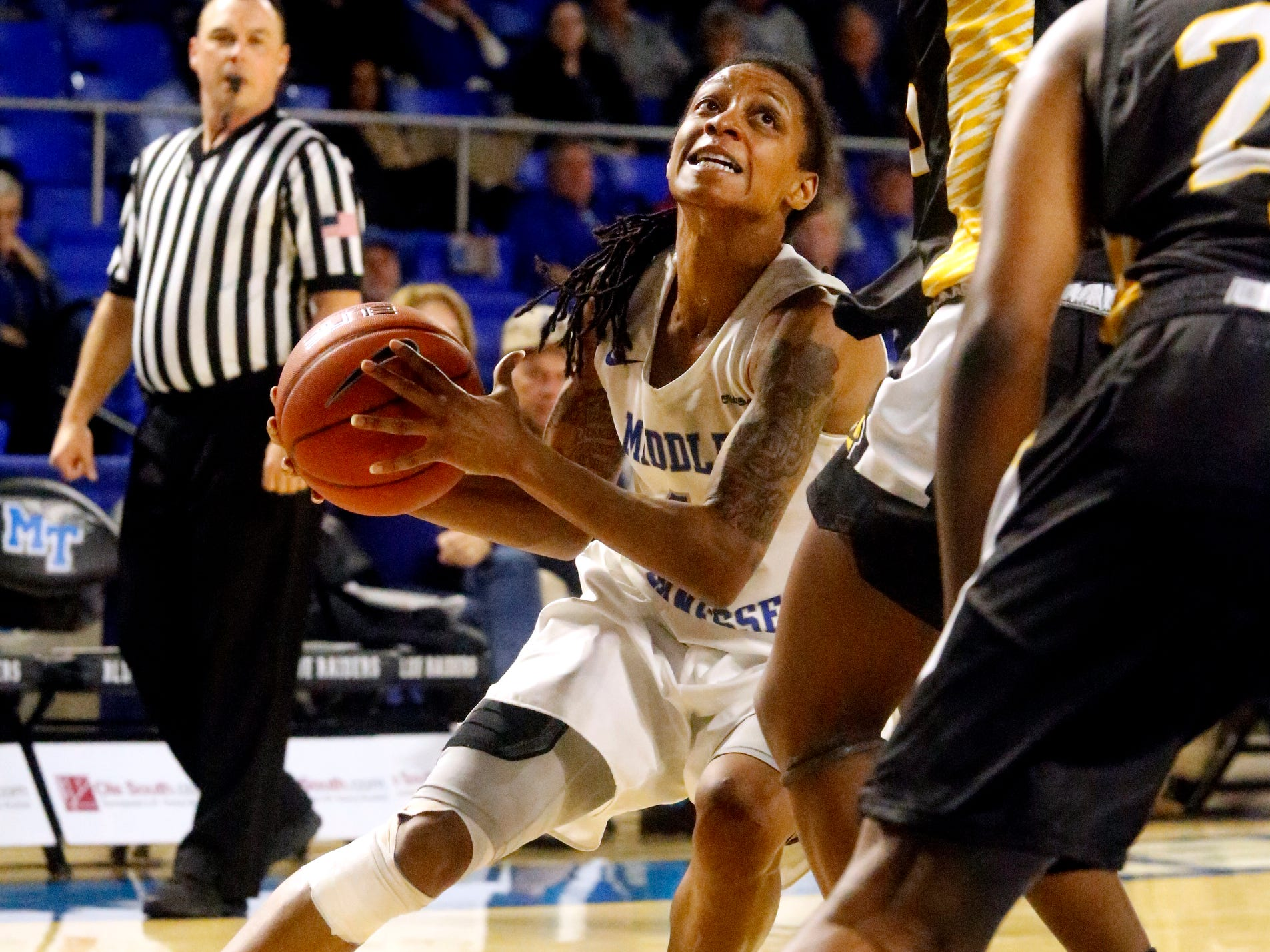 MTSU's guard A'Queen Hayes (1) pushes toward the basket during the game against Southern Miss, on Thursday Jan. 10, 2019.