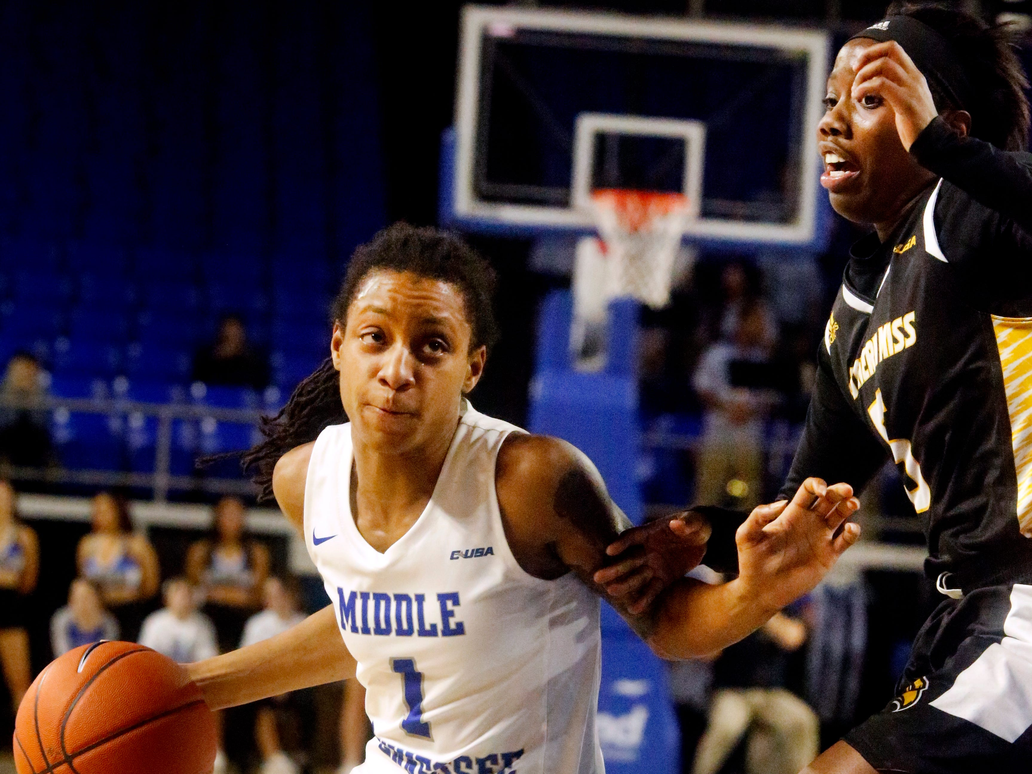 MTSU's guard A'Queen Hayes (1) pushes around Southern Miss' Shonte Hailes (5) to head to the basket, on Thursday Jan. 10, 2019.