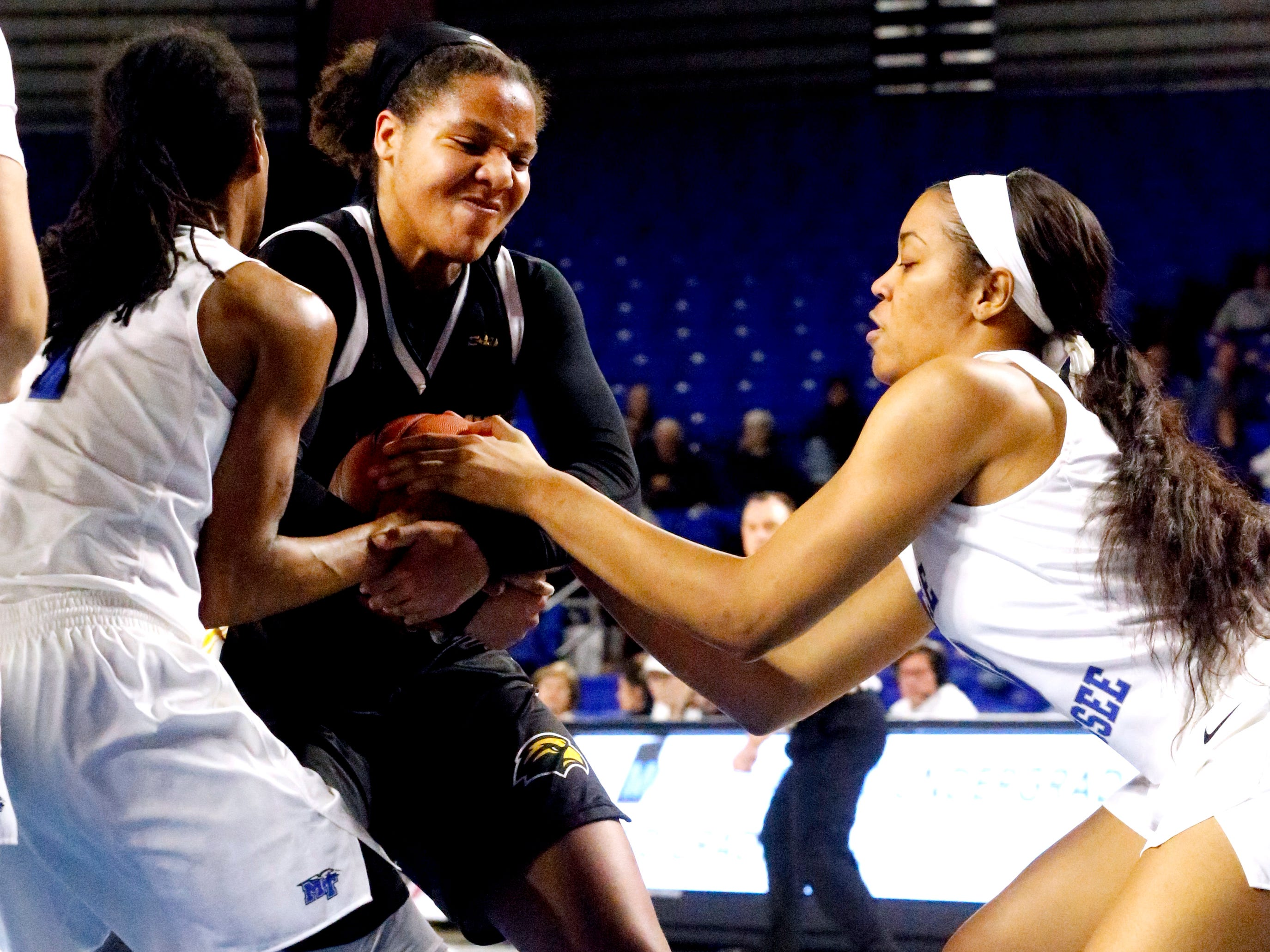 MTSU's guard A'Queen Hayes (1), Southern Miss' Megan Brown (22) and MTSU's forward Jordan Majors (13) all fight for the ball, on Thursday Jan. 10, 2019.