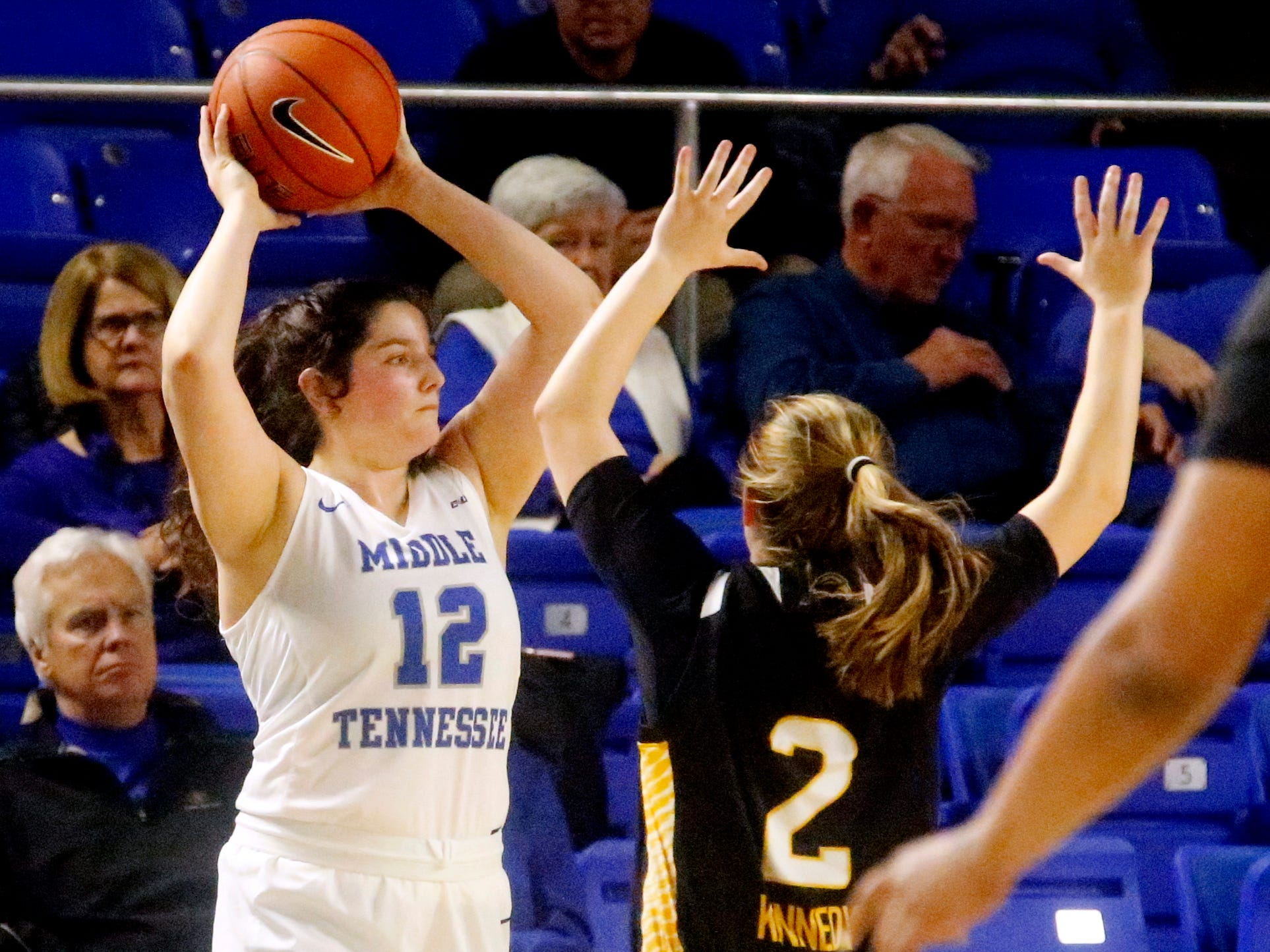 MTSU's guard Jess Louro (12) looks to pass the ball as she is covered by Southern Miss' Allie Kennedy (2), on Thursday Jan. 10, 2019.