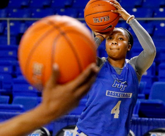 MTSU's Anastasia Hayes shoots a three point basket as she works out with MTSU's assistant women's coach Matt Insell before the Southern Miss game on Thursday Jan. 10, 2019.