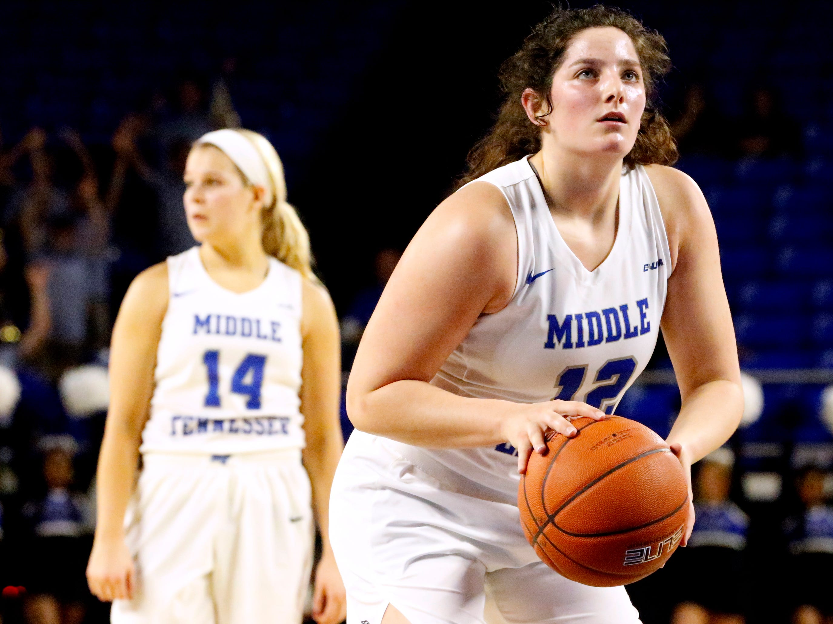 MTSU's guard Jess Louro (12) shoots a free throw as MTSU's guard Katie Collier (14) stands behind her during the game against Southern Miss on Thursday Jan. 10, 2019.