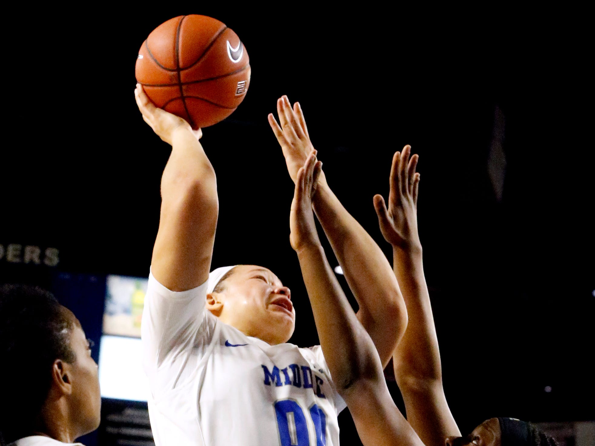 MTSU's forward Alex Johnson (00) shoots the ball as she is guarded by Southern Miss' Kennedy Gavin (24) on Thursday Jan. 10, 2019.