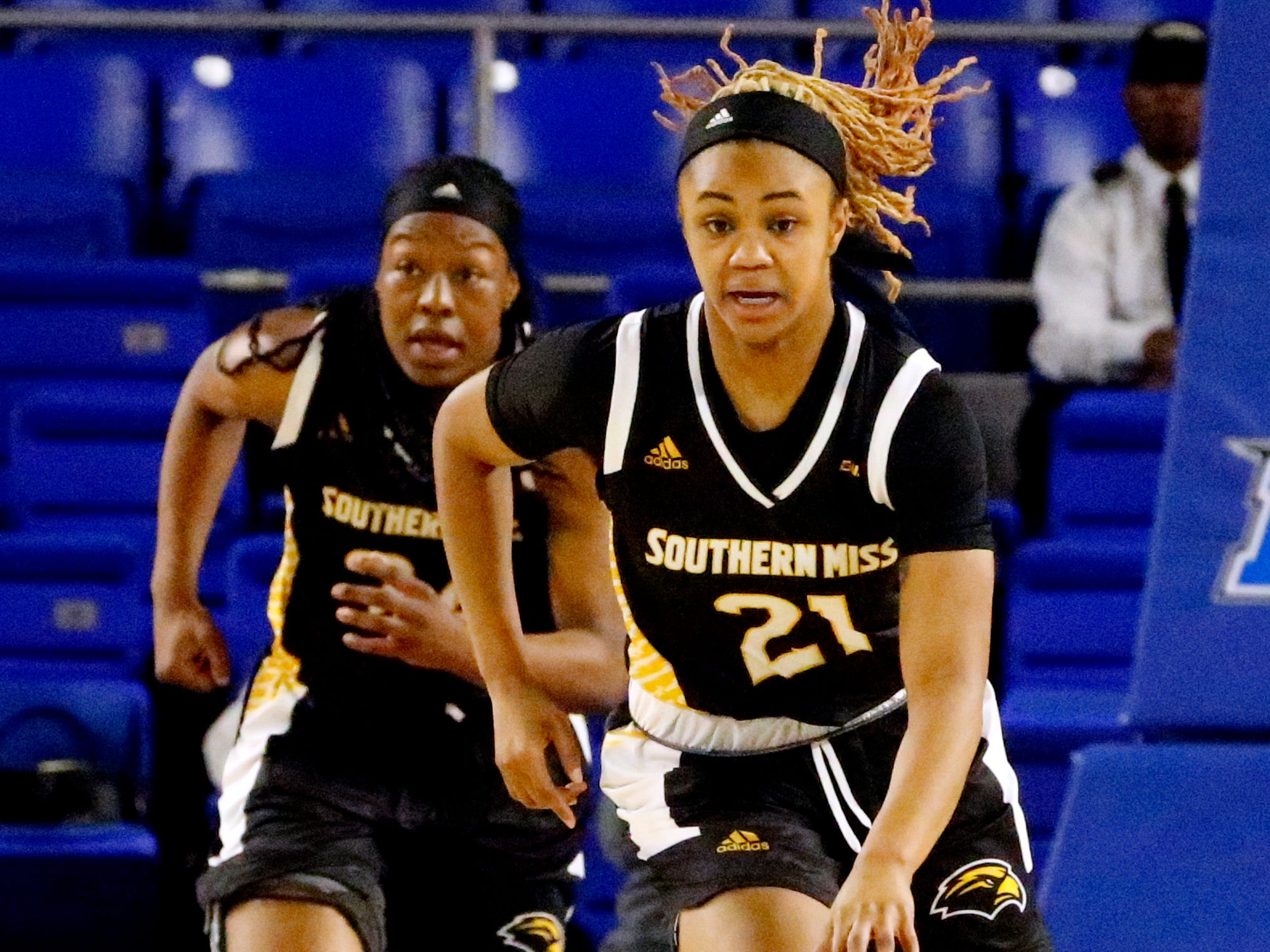 Southern Miss' Daishai Almond (21) brings the ball down the court during the game against MTSU on Thursday Jan. 10, 2019.