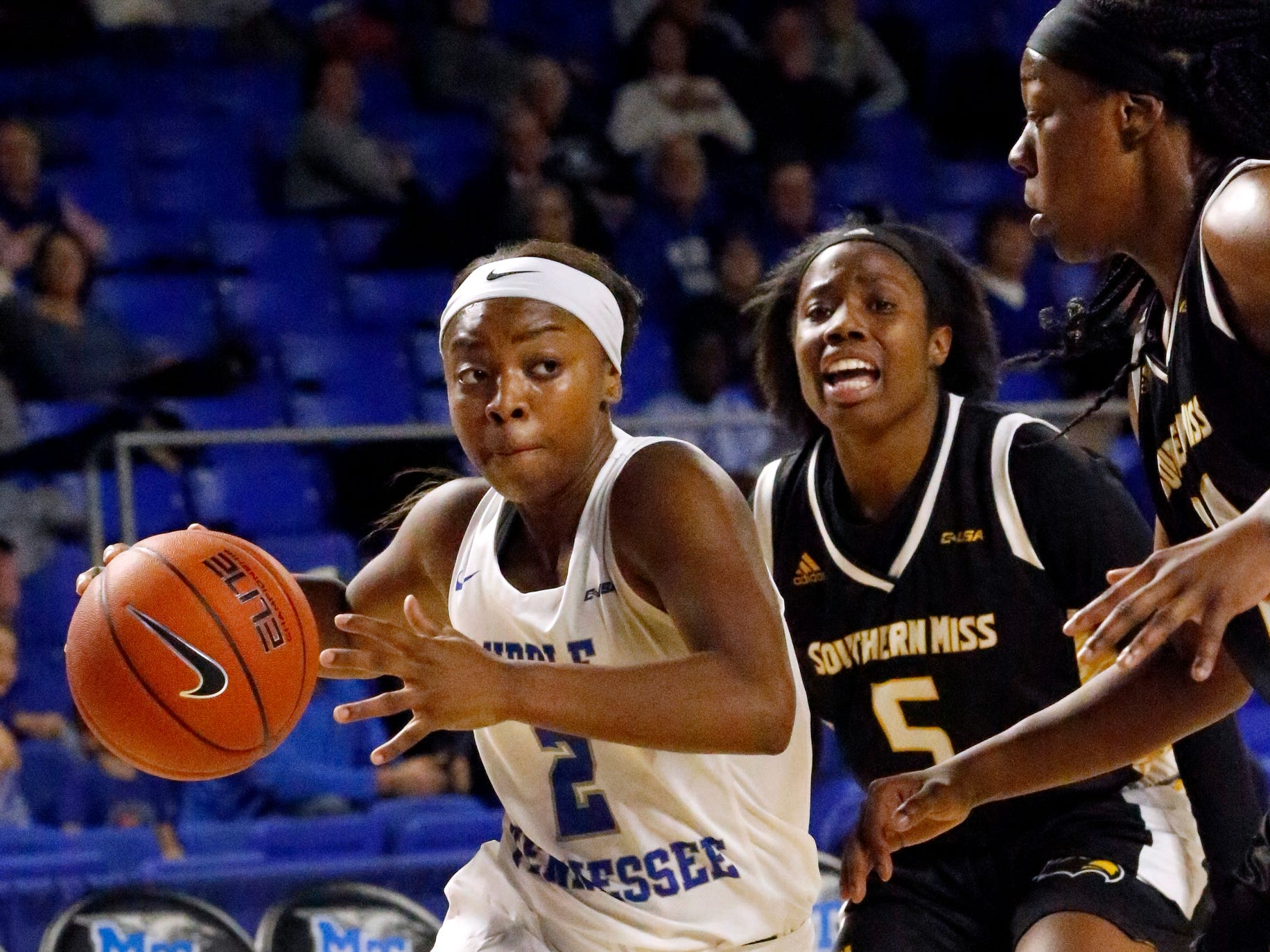 MTSU's guard Taylor Sutton (2) pushes toward the basket around Southern Miss players on Thursday Jan. 10, 2019.