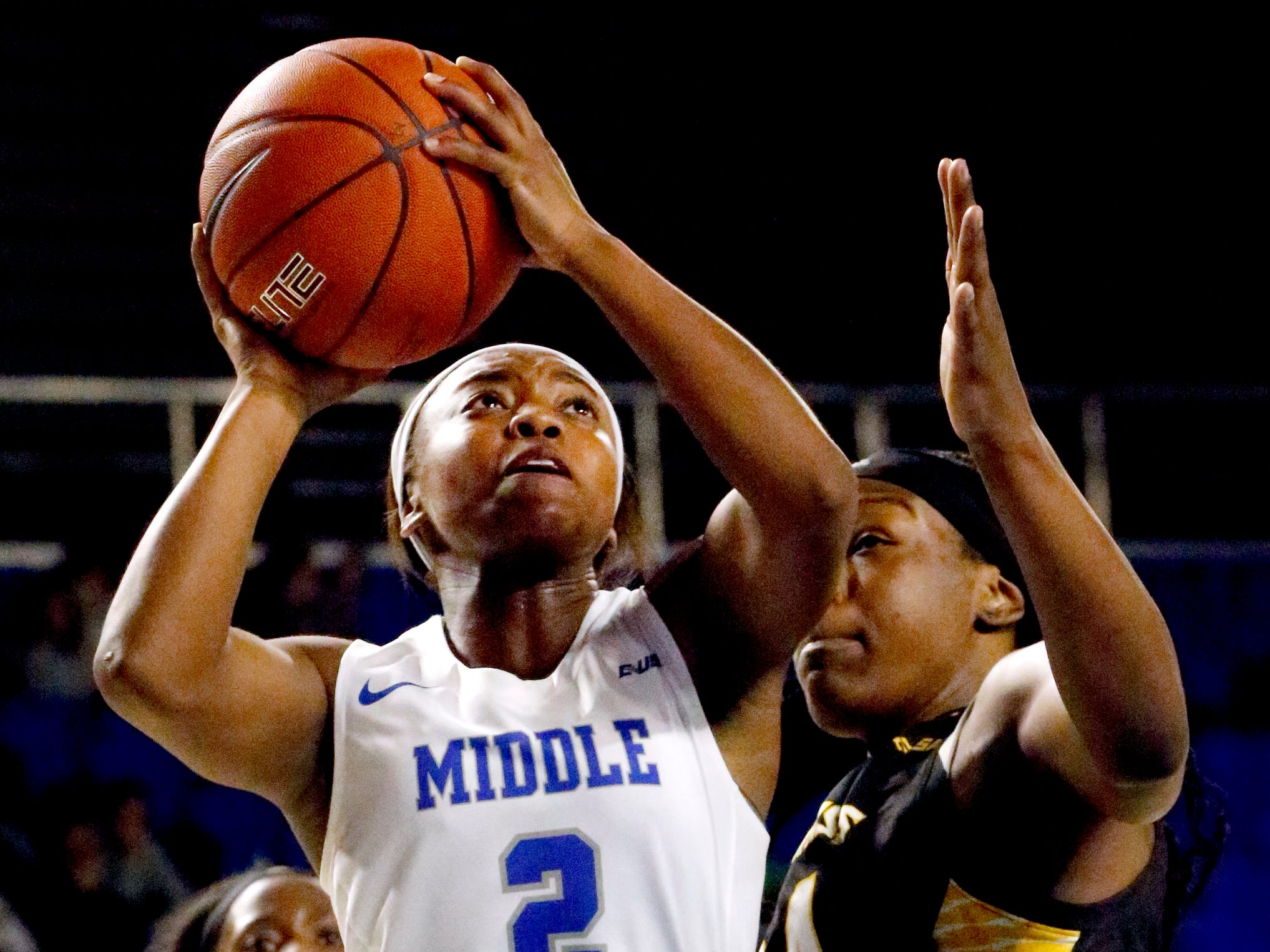 MTSU's guard Taylor Sutton (2) shoots the ball as Southern Miss' Kennedy Gavin (24) guards her on Thursday Jan. 10, 2019.