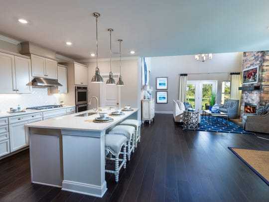 This Meritage kitchen in Foxland Harbor opens to the main living area.