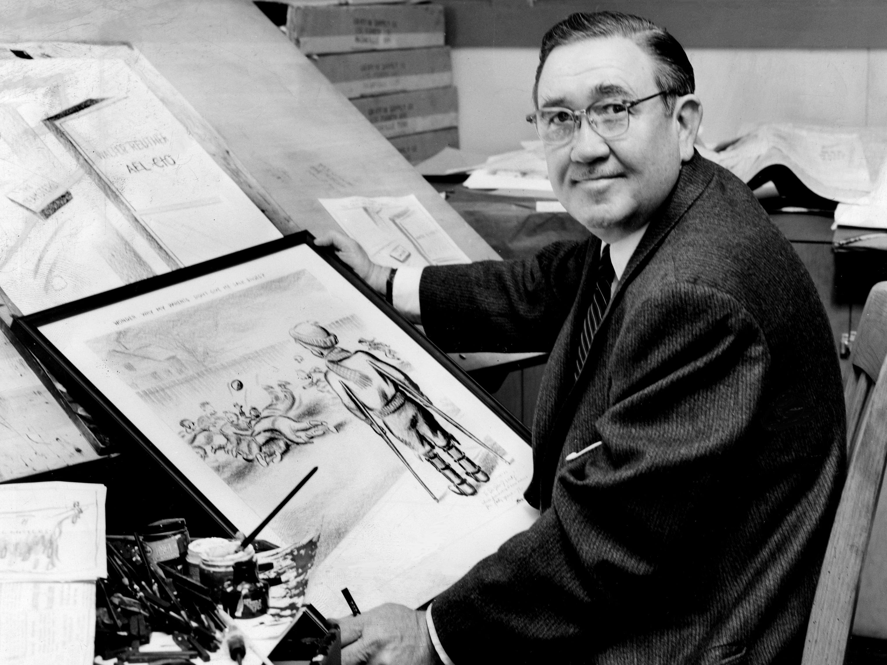 Tennessean editorial cartoonist Tom Little looks up from his sketch Feb. 4, 1959, that won him a Pulitzer Prize two years before.