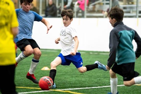 Rowan Winters, 9, kicks the ball during soccer practice for 7- through 10-year-olds at Crockett Park in Brentwood, Tenn., Thursday, Jan. 10, 2019.