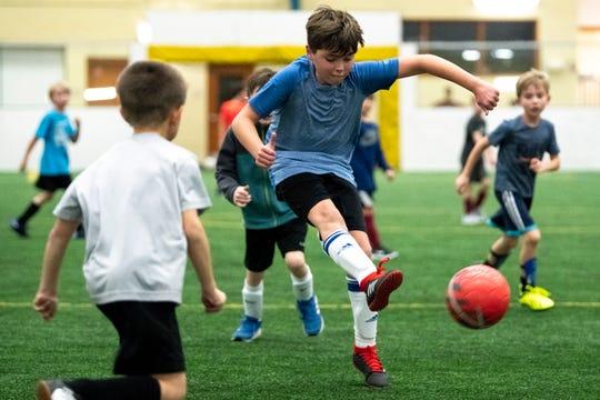 Steel Thomas, 10, kicks the ball during soccer practice for 7- through 10-year-olds at Crockett Park in Brentwood, Tenn., Thursday, Jan. 10, 2019.