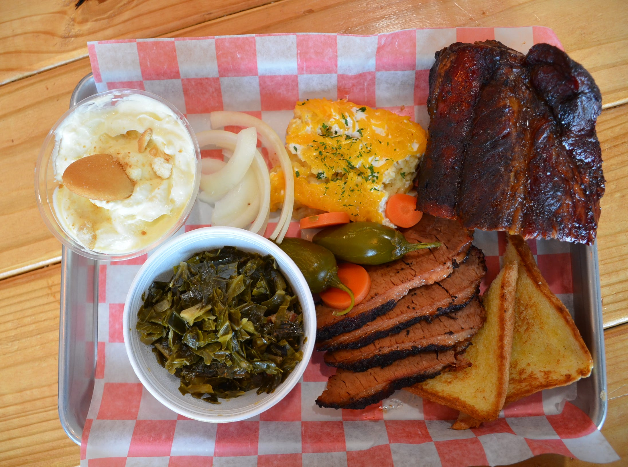 The Texas Two Step choice of two meats and two sides is a popular menu item at The Meat Sweats BBQ in Hendersonville, which also has banana pudding.