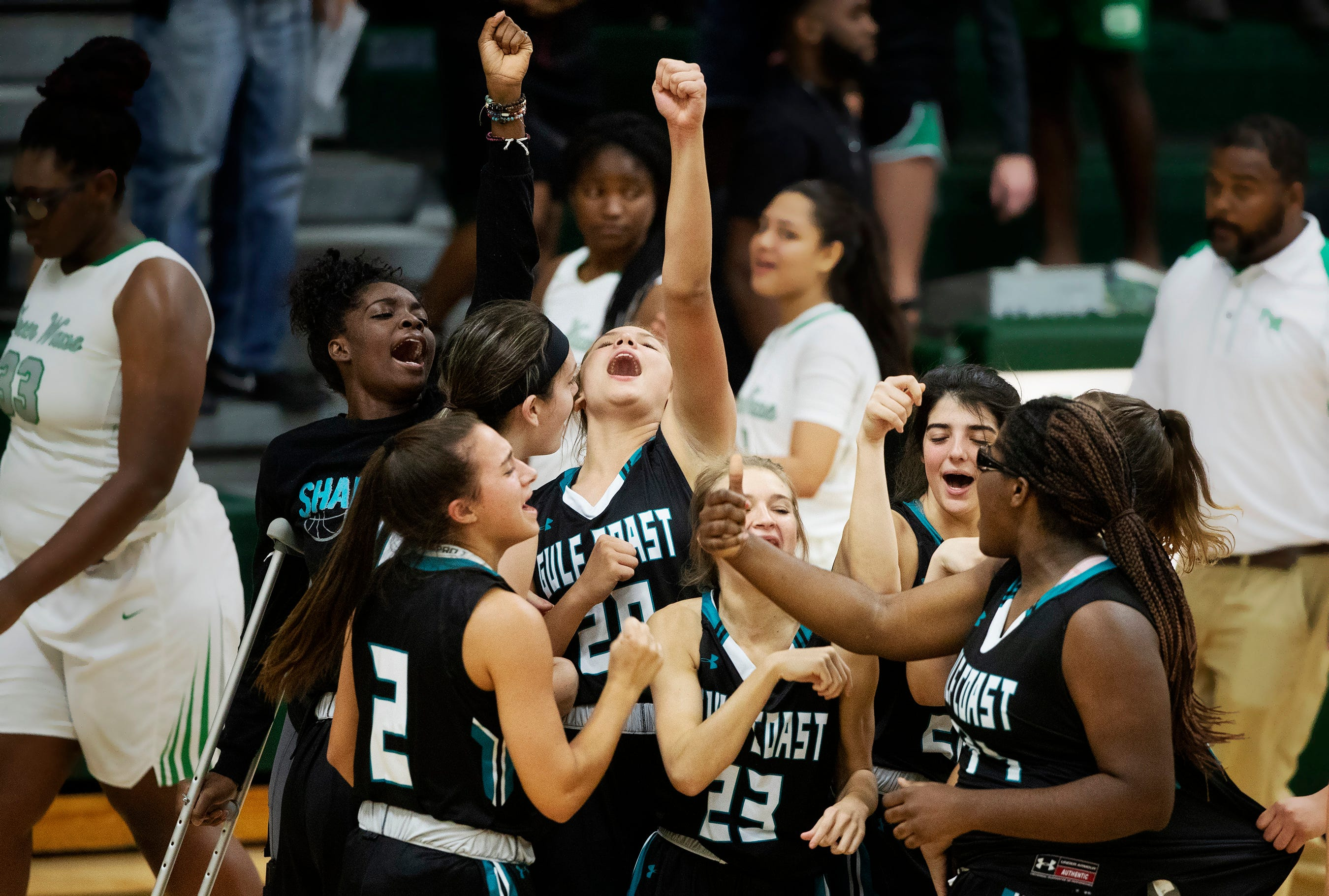 Gulf Coast High School basketball players celebrate beating Fort Myers 71-67 this season. Next year all the Sharks' winter sports teams will be in the states largest classifications.