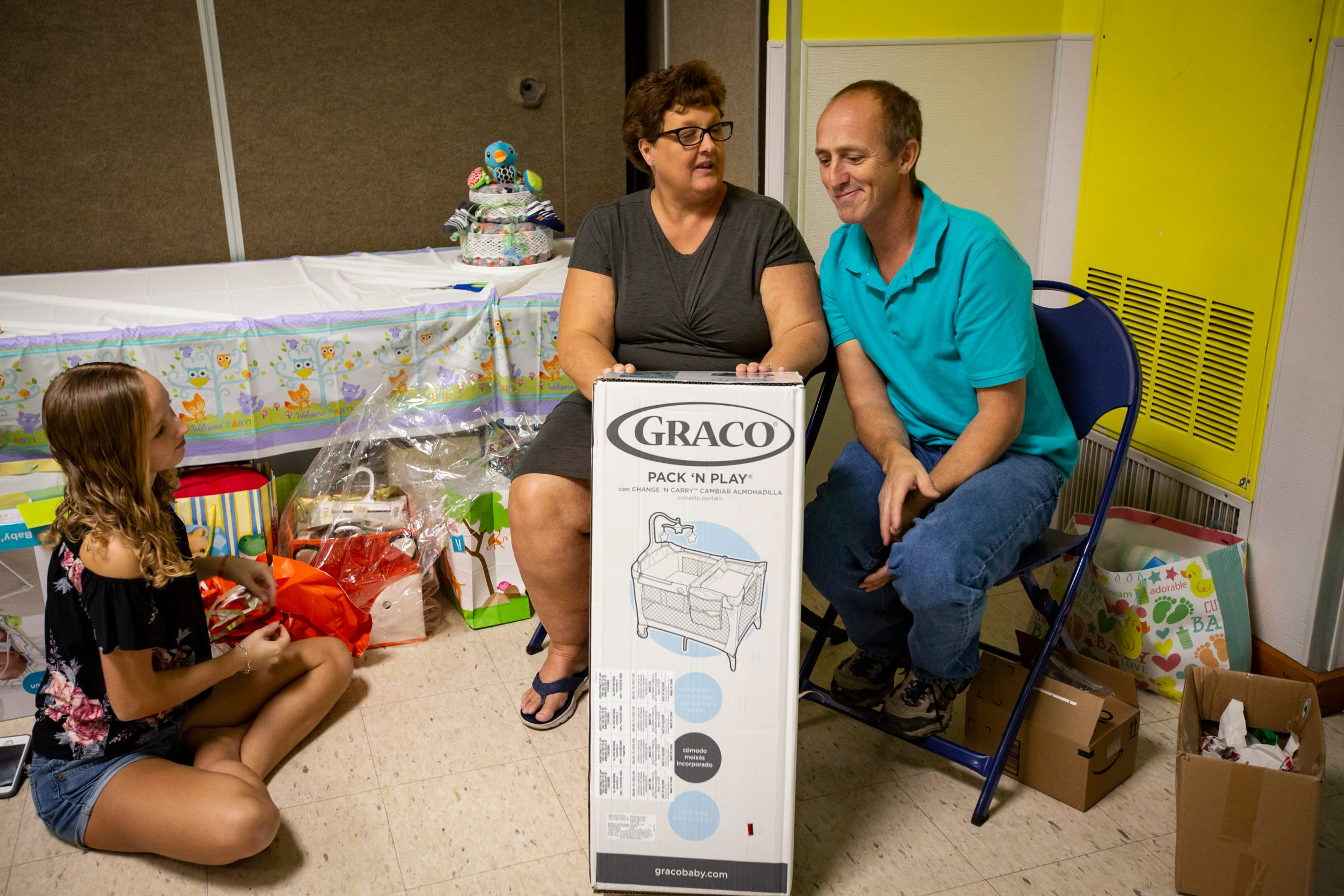 Michele Hall, her husband, Jerry, and their 14-year-old daughter, Aubrey, open presents during Michele's baby shower on Dec. 15, 2018, at Vineyards Park community center in North Naples.  Michele learned about her pregnancy on Oct. 8, 2018, and at that point she was 26 weeks into her pregnancy. At 50, Michele never thought she would have another child after Aubrey, her youngest. But, on Dec. 27, 2018, baby Grayson Matthew Hall was born at NCH North Naples Hospital.