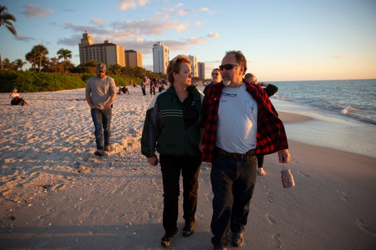 Mary and John Scholtz walk on Vanderbilt Beach in North Naples during the annual Twins Tot Vigil on Friday, Jan. 11, 2019. Their daughter Ivy Rose Scholtz drowned in June 2006 .
