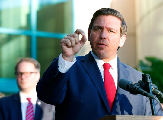 Florida Gov. Ron DeSantis speaks at the Broward County Sheriff's Office Fort Lauderdale headquarters, Friday, Jan. 11, 2019, in Fort Lauderdale, Fla. DeSantis suspended Broward County Sheriff Scott Israel on Friday over his handling of February's massacre at Marjory Stoneman Douglas High School. (AP Photo/Wilfredo Lee)