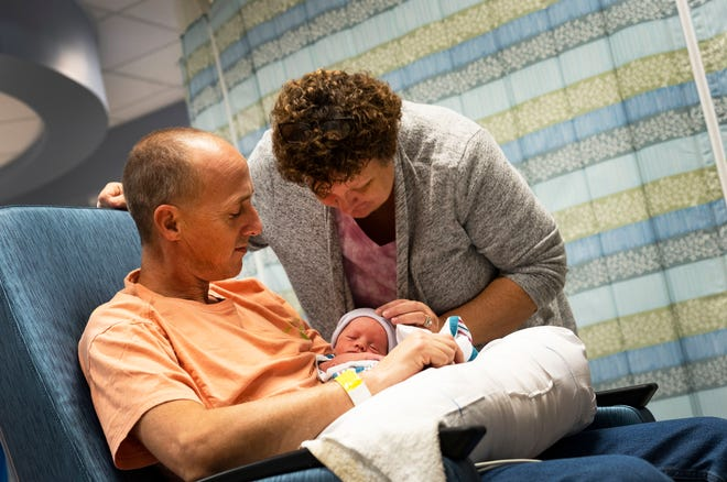 Michele Hall  and her husband, Jerry, share a moment with their newborn son, Grayson, at the NCH North Naples Hospital NICU on Saturday afternoon, Jan. 5, 2019.