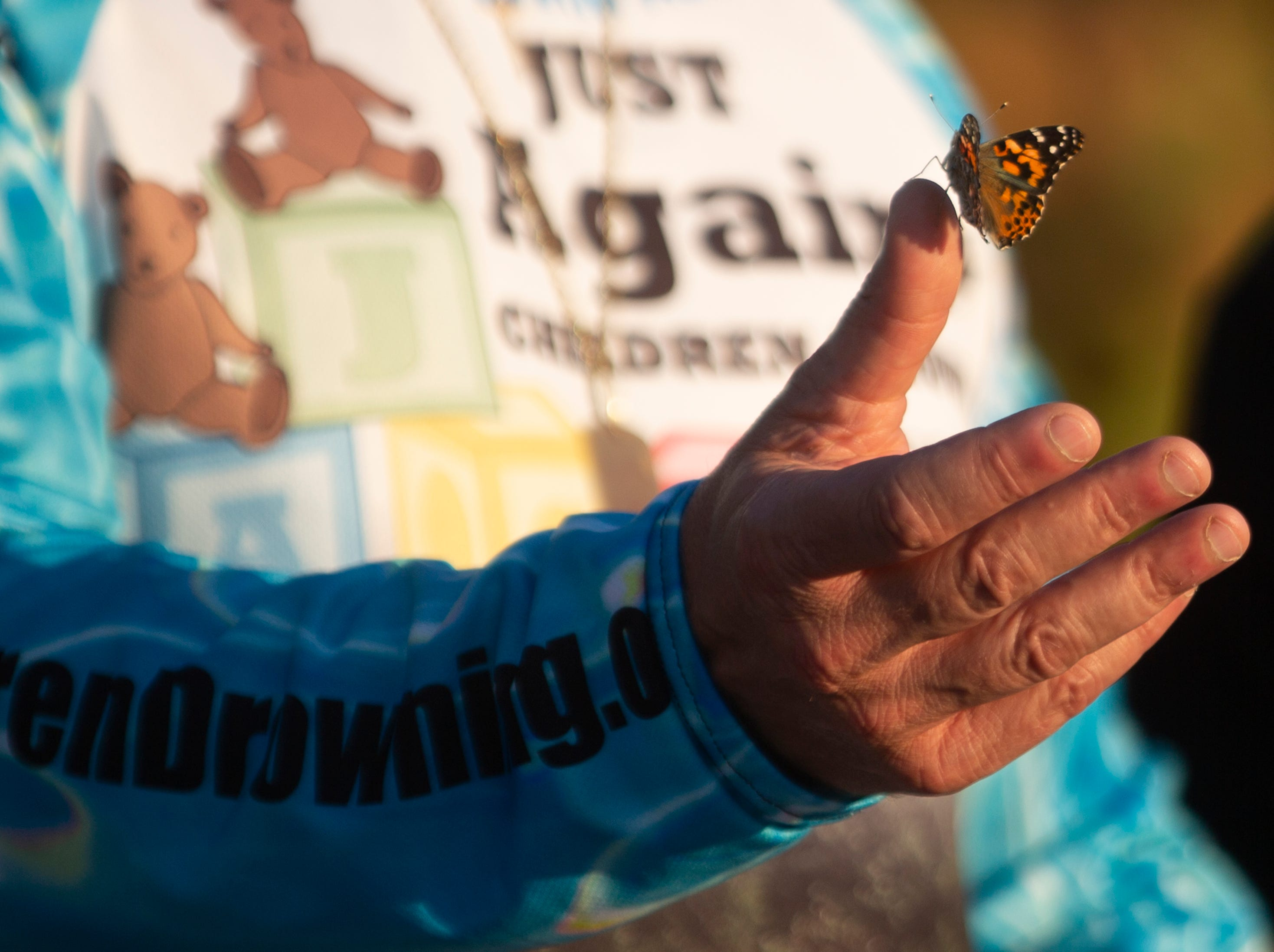 Paul J DeMello releases a butterfly in honor of his twin sons  Josh and Christian who passed away 9-years ago due to drowning during the 6th Annual Twin Tot Walk Vigil, Friday, Jan. 11, 2019 at Vanderbilt Beach.