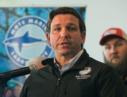 In this Jan. 10, 2019 file photo, Republican Gov. Ron DeSantis announces funding for his environmental policy during a press conference at Mote Marine Laboratory in Sarasota.