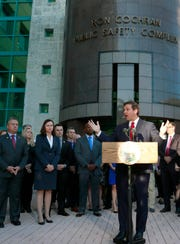 Florida Gov. Ron DeSantis, foreground, speaks at the Broward County Sheriff's Office Fort Lauderdale headquarters, Friday, Jan. 11, 2019, in Fort Lauderdale, Fla. DeSantis suspended Broward County Sheriff Scott Israel on Friday over his handling of February's massacre at Marjory Stoneman Douglas High School.