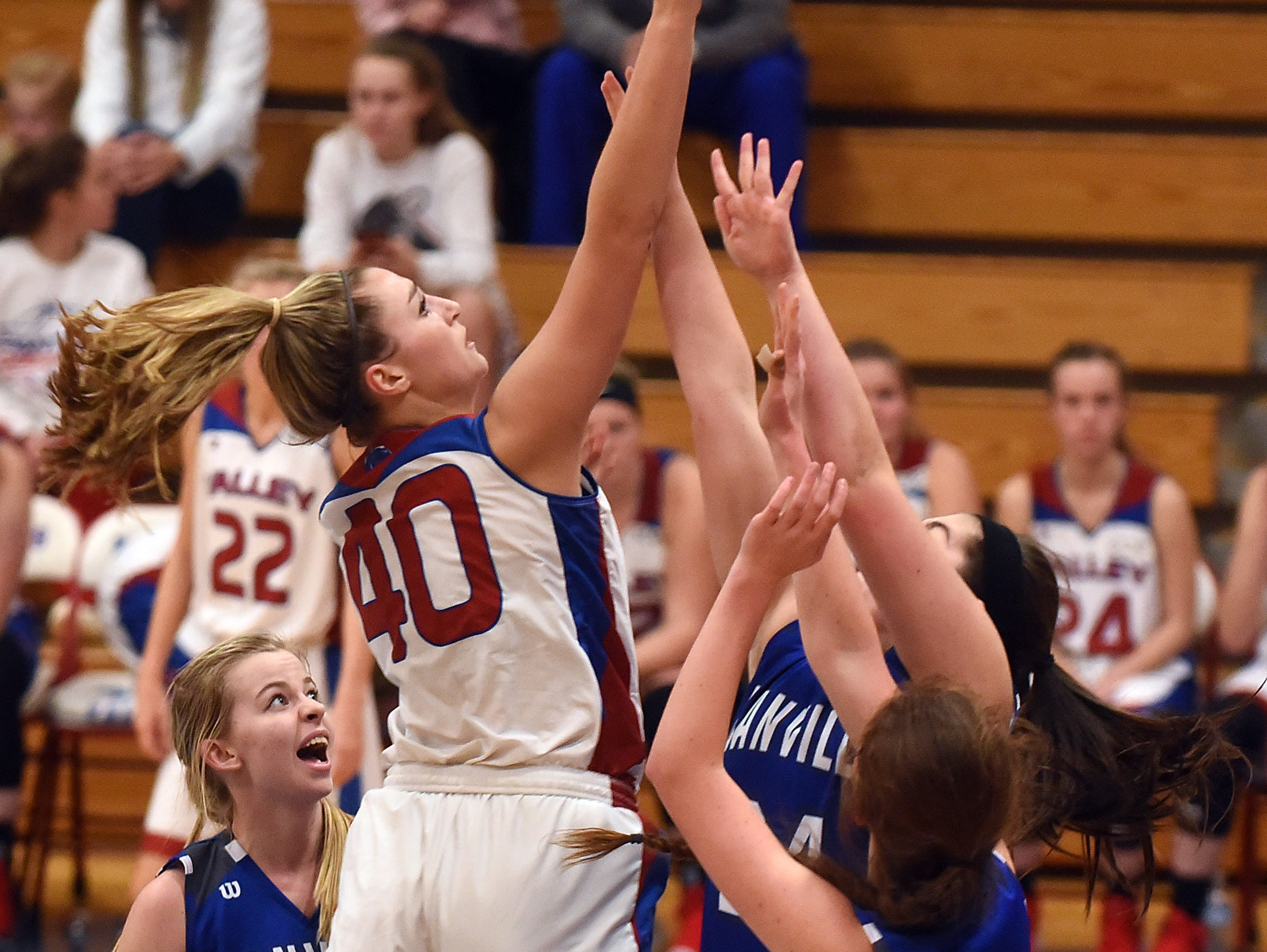 Licking Valley's Emily Hartshorn shoots for two against defense from a host of Danville defenders during a game on Thursday, Jan. 10, 2019. The Panthers won 70-42.