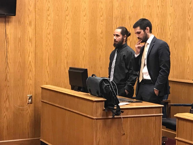 Christopher Bridie (left) addresses Judge David Branstool alongside his attorney Michael DalSanto (right) during a sentencing hearing in Licking County Common Pleas Court on Friday, Jan. 11, 2019.