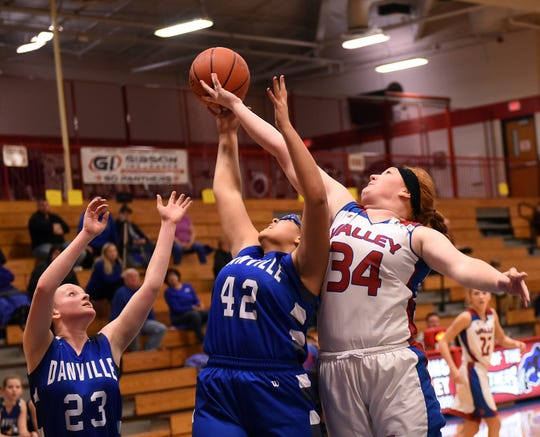 Danville's Bobbi Berger and Cece Newbold vie for a rebound against Licking Valley's Jalyn Taylor during a game on Thursday, Jan. 10, 2019. The Panthers won 70-42.