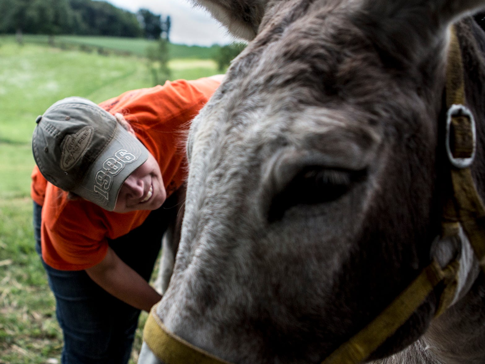 Mamie Hollenback greets the family donkey, Dee, while checking to see if her baby is close to being born. Dee ended up miscarrying the baby, which is one of the many lessons in the cycle of life her two sons learn by living on a farm.