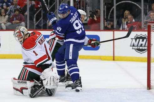 Jan 10, 2019; Newark, NJ, USA; Toronto Maple Leafs center John Tavares (91) and New Jersey Devils defenseman Andy Greene (6) battle for the puck after a save by New Jersey Devils goaltender Keith Kinkaid (1) during the first period at Prudential Center.