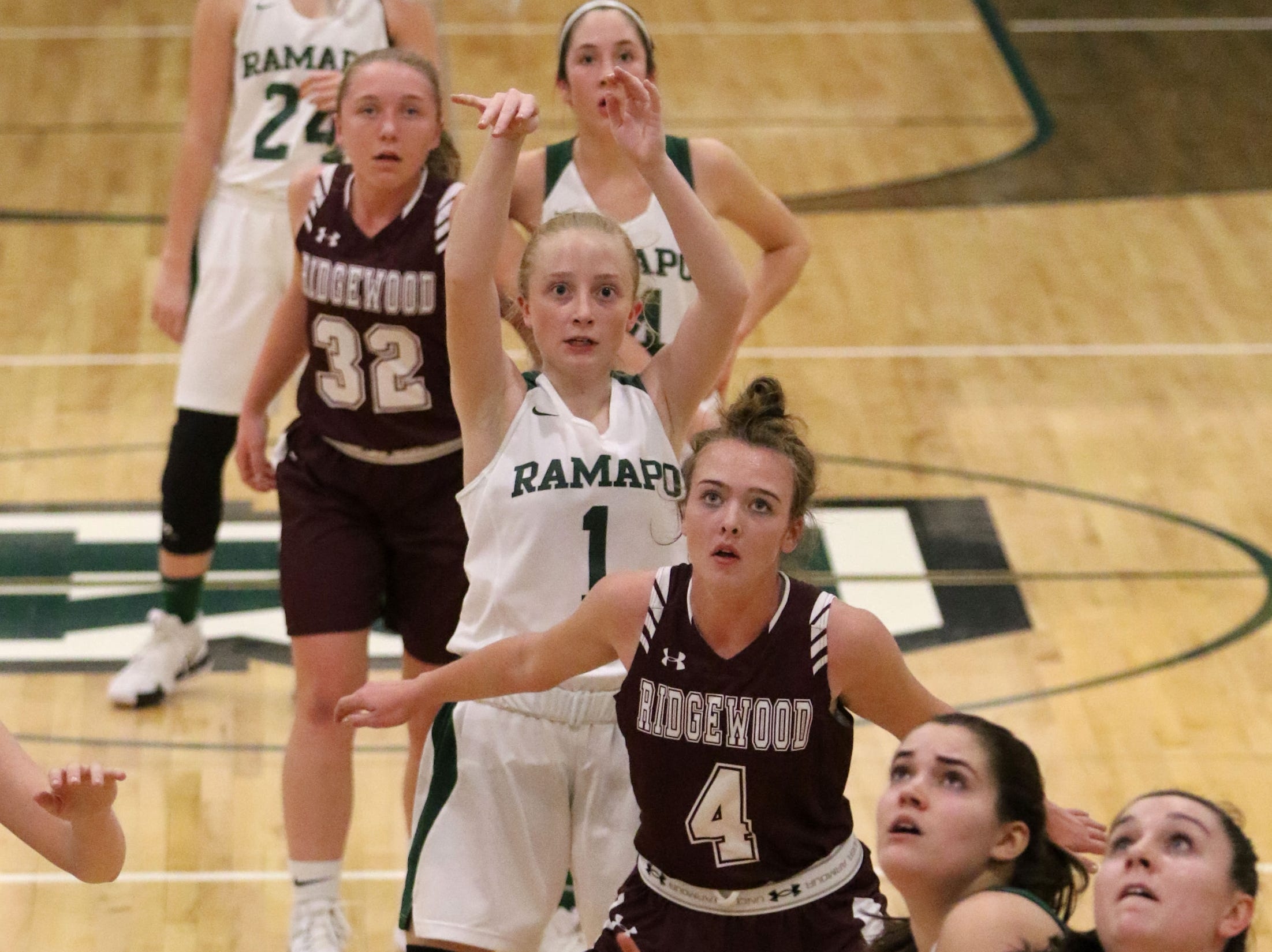 Nowak Savannah, of Ramapo, eyes the basket to see if her shot will be good.  Her shot went off the rim but The Raiders won anyway, 42-36. Thursday, January 10, 2019