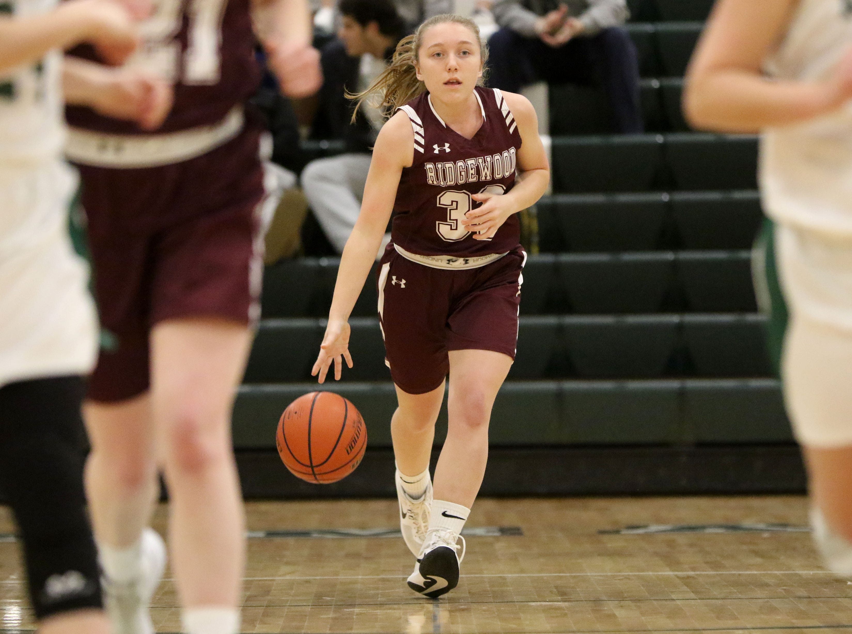 Allie Olsen, of Ridgewood, brings the ball across the court. Thursday, January 10, 2019