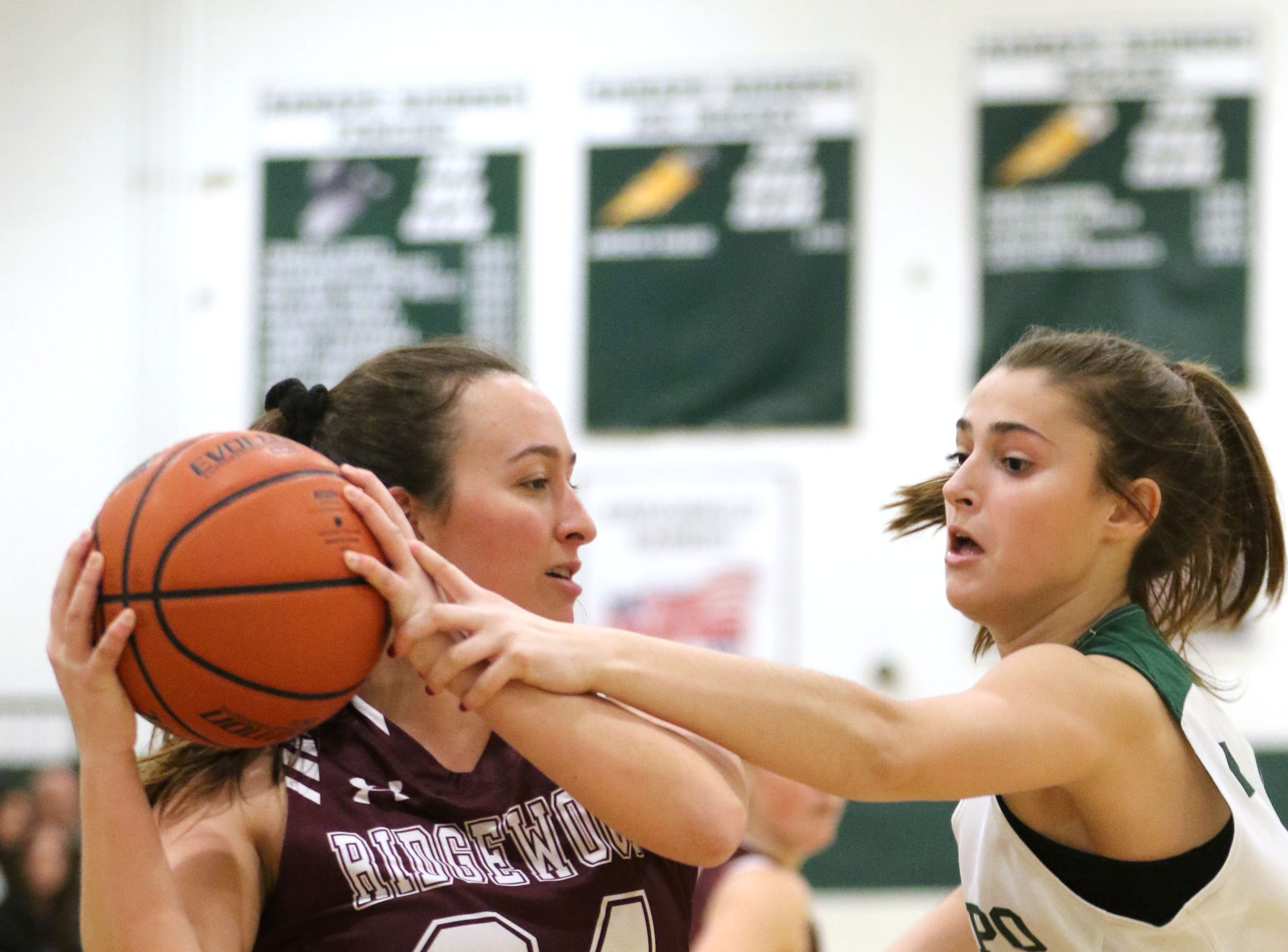 Maddie Sullivan, of Ridgewood, tries to keep the ball away from Madison Schiiler, of Ramapo. Thursday, January 10, 2019