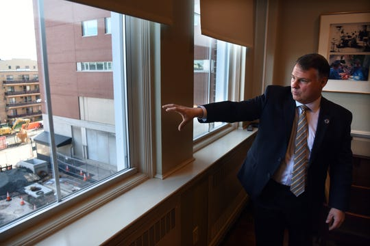 Mark Sparta, president of Hackensack University Medical Center, looks out onto Second St. in Hackensack where construction is underway on the Second Street Tower, a 500,000 sq. ft. expansion of HUMC that will feature private rooms, intensive care beds and new operating suites.
