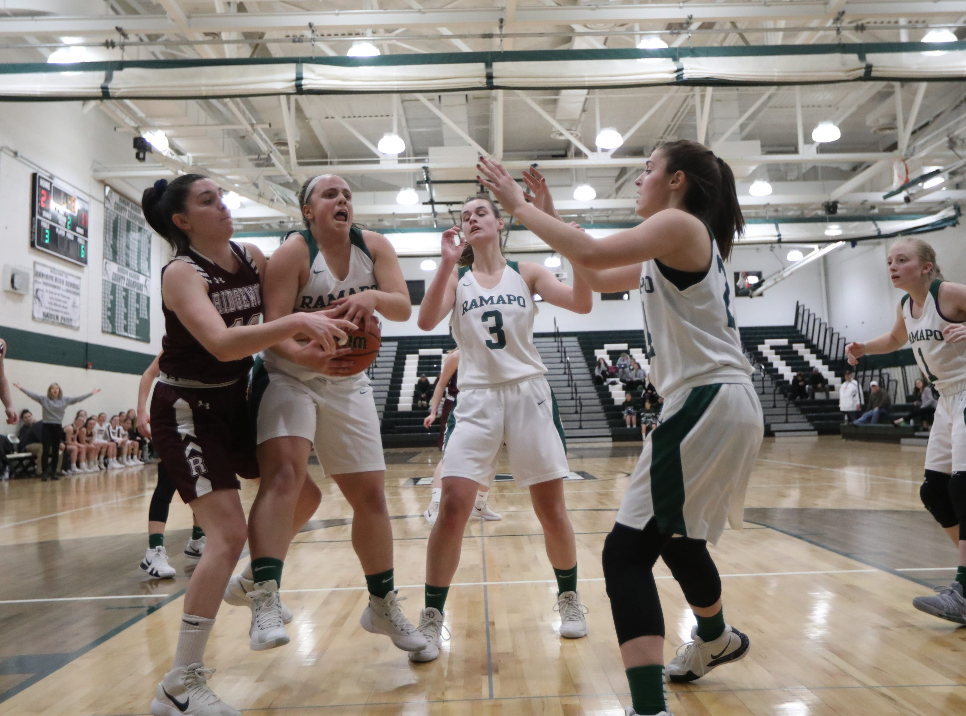 Hagan Gorman, of Ridgewood, and Jenny Amato, of Ramapo, battle for the ball in the first half. Thursday, January 10, 2019