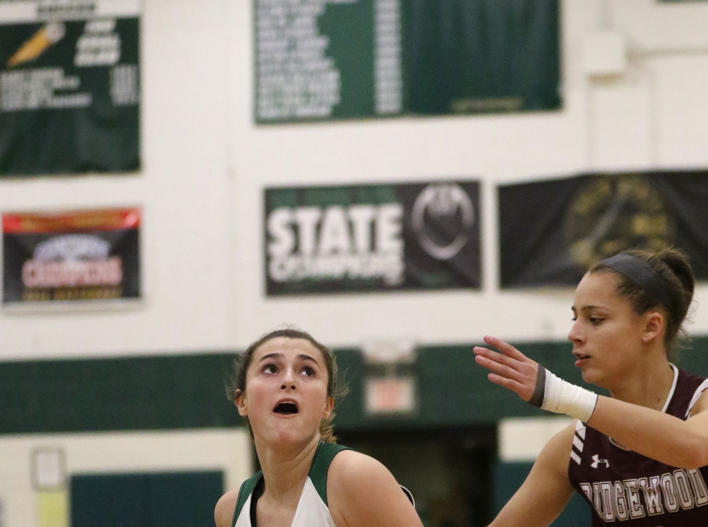 Madison Schiller, of Ramapo, looks past Jackie Wolak, of Ridgewood,  Thursday, January 10, 2019.