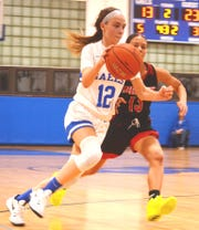 St. Mary guard Janea Kelty driving by Weehawken's Allish DeLeon.
