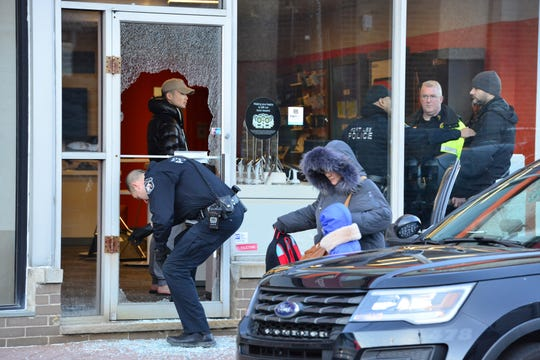 Fort Lee Police and Bergen County Sheriff Crime Scene Unit are on scene at a break in at the AT&T store on Lemoine Ave in Ft. Lee, on Friday January 11, 2019. Shattered glass on the sidewalk where the front door was broken.