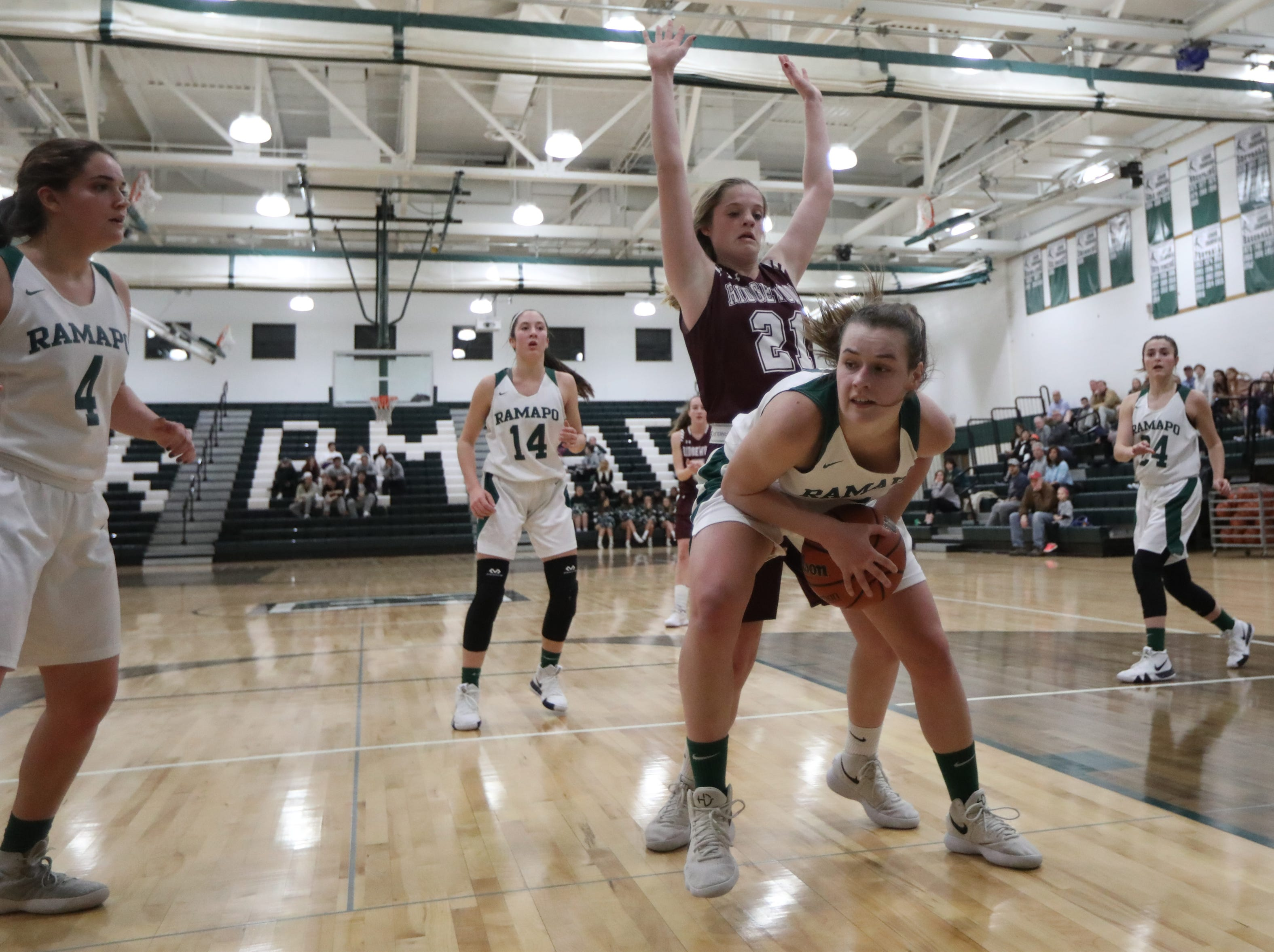 Laurren Achter, of Ramapo, holds onto the ball in front of . Chloe Lennon, of Ridgewood. Thursday, January 10,  2019